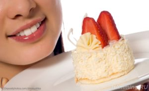 young woman with strawberries cake (isolated on white)